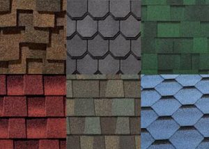 multiple colors and shapes of asphalt roofing shingles